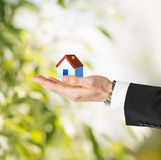 Man hands holding eco house Stock Images