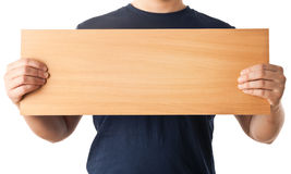 Man hands holding an empty wooden board. With space for text Royalty Free Stock Photo