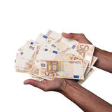 Man Hands holding euros banknotes isolated. Man Hands holding a pile of fifty euros banknotes, with clipping path on white background royalty free stock images