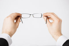 Man hands holding eyeglasses Royalty Free Stock Photo