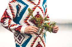 Man hands holding fir tree branch Fashion Travel Lifestyle Royalty Free Stock Photography