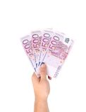 Man hands holding five hundred euro banknotes. Isolated on a white background Royalty Free Stock Photos