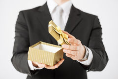 Man hands holding gift box Stock Images