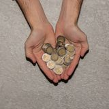 Man hands holding a heap of euro coins background, top view stock images