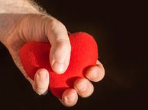 Man hands holding a heart stock images