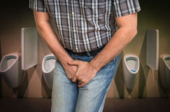 Man with hands holding his crotch, he wants to pee stock image