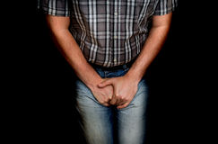 Man with hands holding his crotch, he wants to pee Stock Photos