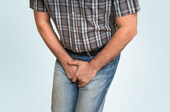Man with hands holding his crotch, he wants to pee Royalty Free Stock Photos