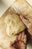 Man hands holding homemade heart shaped pastry Royalty Free Stock Photo