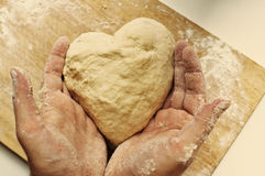 Man hands holding homemade heart shaped pastry Stock Photos