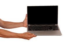 Man Hands holding a laptop isolated on white background Royalty Free Stock Photography