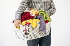 Man hands holding laundry basket royalty free stock image