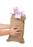 Man hands holding money bag full with euro bills Royalty Free Stock Images
