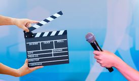 Man hands holding movie clapper.Film director concept. hands holding Microphone in interview or broadcast wedding ceremony,