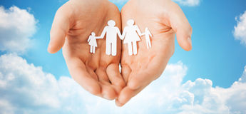 Man hands holding paper cutout of family Royalty Free Stock Images