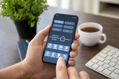 Man hands holding phone with app smart home on screen stock image