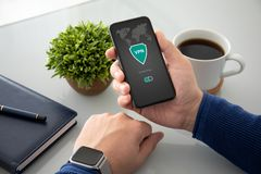 Man hands holding phone with app vpn private network. Man hands with watch holding phone with app vpn creation Internet protocols for protection private network royalty free stock photos