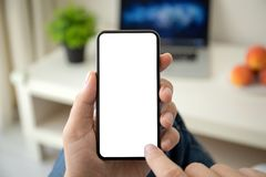 Man hands holding phone with  screen in the room. Man hands holding phone with  screen in the house in room stock images