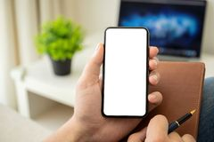 Man hands holding phone with  screen in the room. Man hands holding phone with  screen in the house in room royalty free stock images