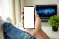 Man hands holding phone with isolated screen in the room. Man hands holding phone with isolated screen in the house in room stock photography