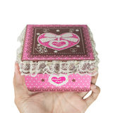 Man hands holding a pink gift box Royalty Free Stock Image