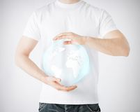 Man hands holding sphere globe. News, technology and environment concept - man hands holding sphere globe Stock Photography