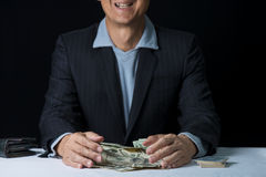 Man hands holding and sweeping money,business concept. Stock Photo