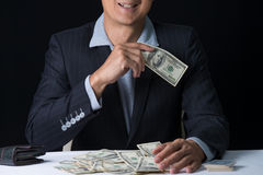 Man hands holding and sweeping money,business concept. Royalty Free Stock Photography