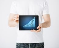 Man hands holding tablet pc with graph. Picture of man hands holding tablet pc with graph Royalty Free Stock Image