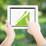 Man hands holding tablet PC with graph Stock Photography