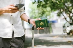 Man hands holding Vietnamese Passport. Ready for traveling. Man hands holding Vietnamese Passport. Ready for traveling Royalty Free Stock Photos