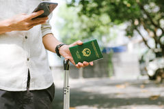 Man hands holding Vietnamese Passport. Ready for traveling Stock Photos