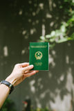 Man hands holding Vietnamese Passport. Ready for traveling Royalty Free Stock Image