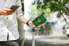 Man hands holding Vietnamese Passport. Ready for traveling. Royalty Free Stock Photography
