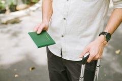 Man hands holding Vietnamese Passport. Ready for traveling.  stock photos