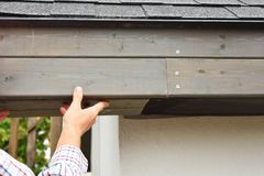 Man hands installing eaves royalty free stock photos