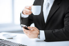 Man hands with keyboard, smartphone and coffee Royalty Free Stock Photo
