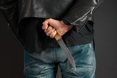 Man hands with knife Stock Photos