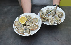 Man hands with lemon and oyster. Royalty Free Stock Photo