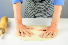 Man hands making dough for dumplings with meat Royalty Free Stock Photos
