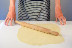 Man hands making dough for dumplings with meat Royalty Free Stock Images