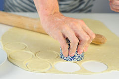 Man hands making dumplings with meat Stock Photography