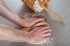 Man hands making yeast dough for estonian pastry Royalty Free Stock Photo