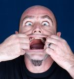 Man with hands in mauth making scared expression Royalty Free Stock Photo