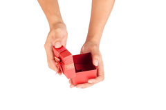 Man hands open lid of red gift box Royalty Free Stock Photo