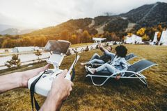 Man hands operating drone which filming two girls royalty free stock image