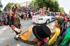 Man Hands Out Candy To Kids At Atlanta Halloween Parade. Atlanta, GA, USA - October 21, 2017:  A parade participant hands out candy to eager kids along the Stock Photo