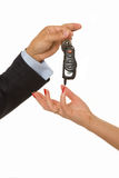Man hands over a bunch of car keys and car alarm. A man hands over a bunch of car keys and car alarm system to a woman Stock Photos