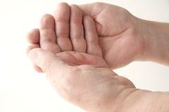Man with hands palm upward Stock Photos