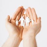 Man hands with paper men Royalty Free Stock Image